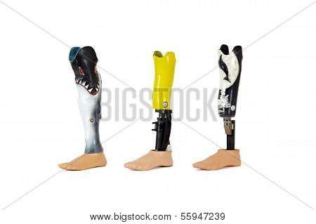 Three Lower Leg Prostheses With Waterprotected Cases Especially Suitable For Swimming.
