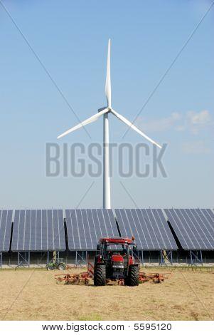 Solar Plant With Wind Turbine At Farm
