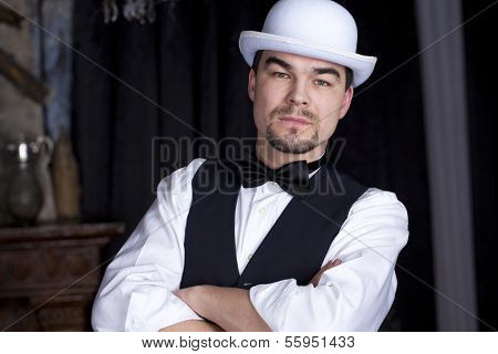 Formidable man in a white bowler hat