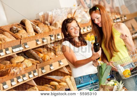 Grocery Store: Two Women Choosing Wine