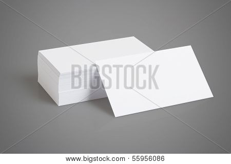 Stack Of Blank White Businesscards On Gray Background