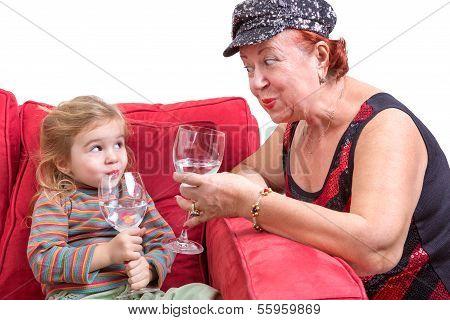 Mischievous Grandmother And Granddaughter
