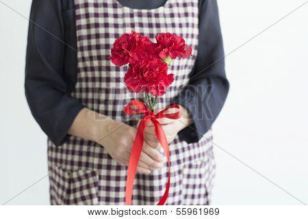 Woman having a carnation