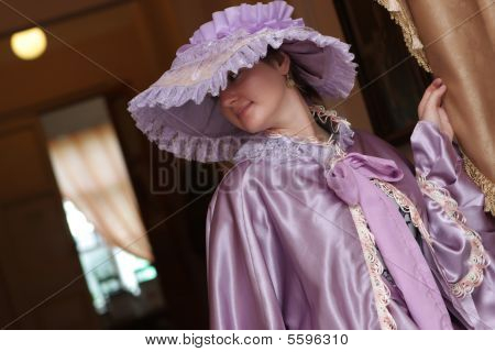 Woman Poses In Old-fashioned Dress