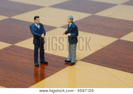 Business Man On A Chess Board