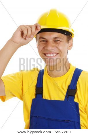 Young Worker Taking Off His Hard Hat And Smile