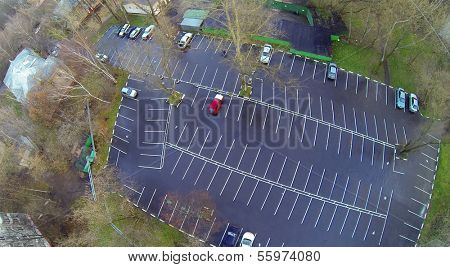 Cars on parking at rainy day. View from unmanned quadrocopter