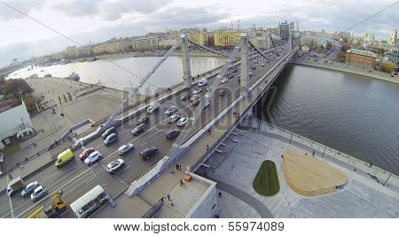 Cars on Krymsky Bridge and panorama of Moscow, Russia. View from unmanned quadrocopter