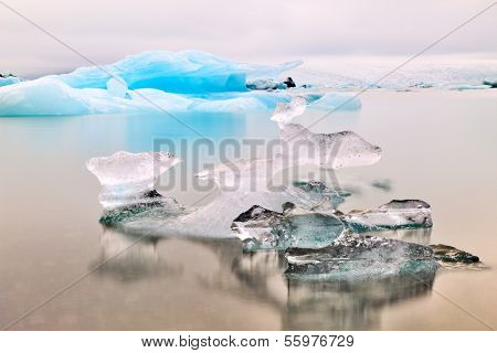 Melting glacier ice at Jokulsarlon lake Iceberg landscape Iceland at Joulsarlon glacier lagoon drifting pack ice melting caused by global warming beautiful arctic travel and tourism location cold