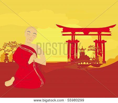 Monk Prays In Sunset