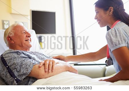 Female Doctor Talking To Senior Man In Hospital Room