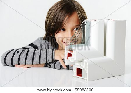 Kid holding plastic window profile