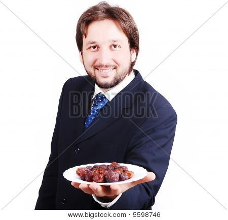 Man In Suit Holding Dates Plate In Front