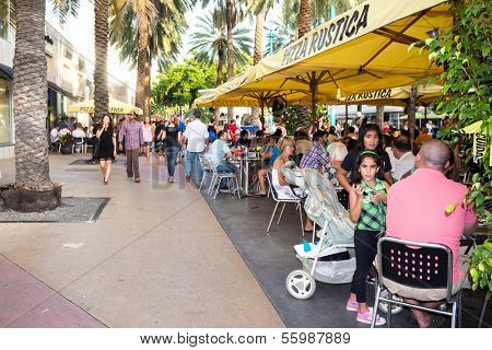 MIAMI,US - NOVEMBER 24,2013:Tourists enjoying the warm weather at Lincoln Road in Miami Beach.This boulevard features over 200 designer boutiques,national retail stores and fine restaurants and bars