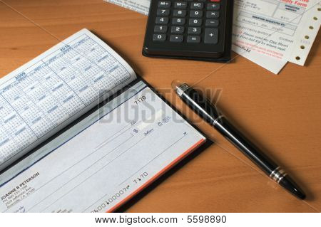 Preparing To Write A Check For The Bills