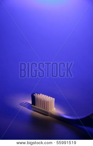 Toothbrush on blue background