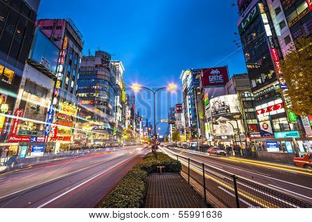 TOKYO, JAPAN - DECEMBER 15, 2012: Traffic passes below billboards in Shinjuku. The area is a famed nightlife district.