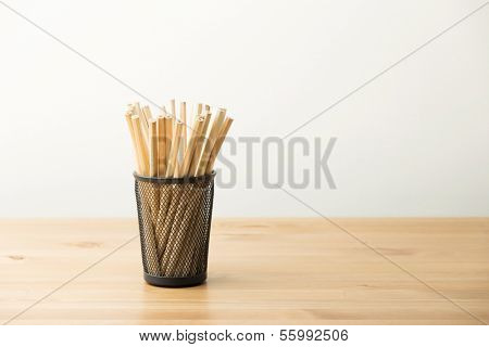 Unsharpened pencil in pot