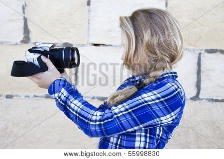 Cool Kid Holding A Camera Taking A Photo Of Herself