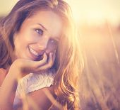 stock photo of lie  - Beauty Fresh Romantic Girl Outdoors - JPG