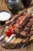 stock photo of souvlaki  - lamb kebab grilled - JPG