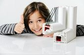 stock photo of hermetic  - Kid holding plastic pvc window profile - JPG