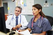 stock photo of nursing  - Doctor With Nurse Working At Nurses Station - JPG