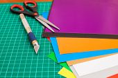 foto of cut torn paper  - Cutting mat with paper and tools.Hobby at home.
