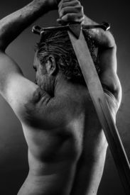 stock photo of longsword  - Wild Warrior with huge metal sword - JPG