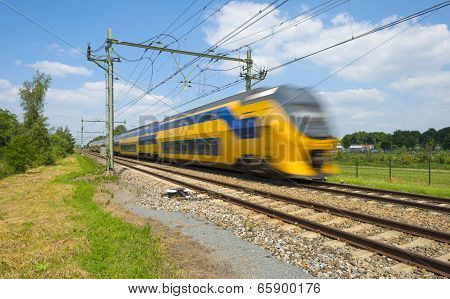 Train riding through the countryside in spring