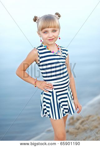 Portrait Of Little Girl On A Summer Beach