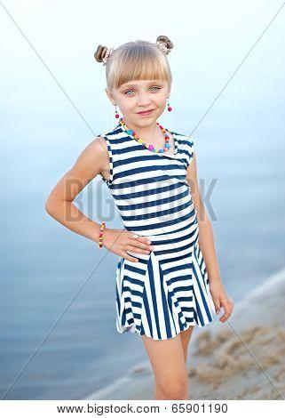 Portrait Of Little Girl On A Summer Beach