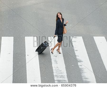 Businesswoman Crossing Street At Crossway