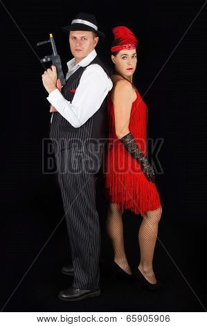 Dangerous Bonny And Clyde Gangster With 1920 Style Clothes Standing With Gun