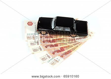 Black Car On A Pack Of Russian Rubles