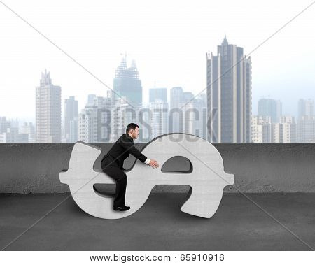 Businessman Sitting On Concrete Money Symbol