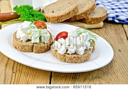 Bread With Cheese And Tomatoes In White Plate