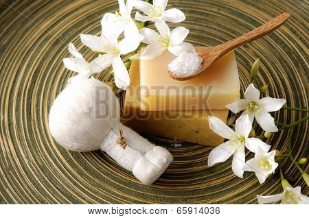 White gardenia flower and massage ball with soap ,spoon on wooden plate