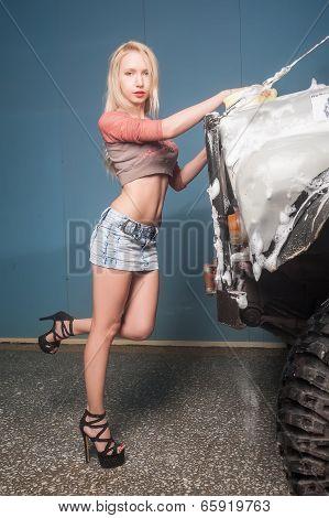 Beautiful woman washing car