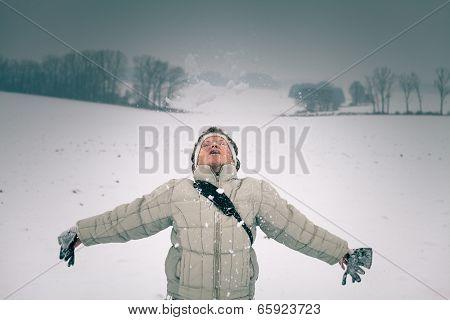 Woman Enjoying Snow
