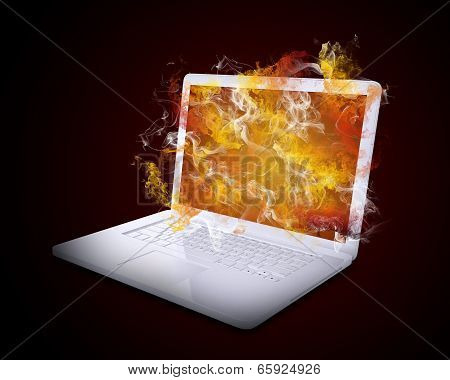 Open white laptop emits colored smoke