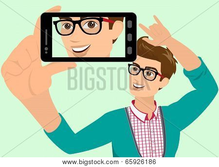 Happy guy is taking selfie