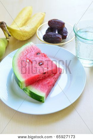 Slices of juicy watermelon with other fruits - a Ramadan food