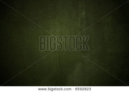 Green stucco wall background with vignette