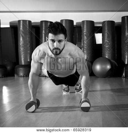 Dumbbells push-ups pushups beard man at fitness gym workout
