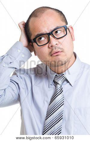 Businessman scratching head