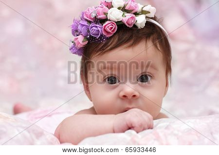 Cute little girl in a floral chaplet