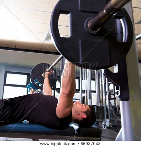 Bench press weightlifting man with in fitness gym