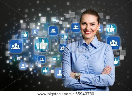 Success business woman standing with crossed arm with social icon in background