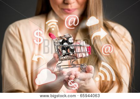 Close up of female shopper with little shopping chart in hands surrounds shopping icons